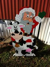 Santa riding a cow in Fort Polk, Louisiana